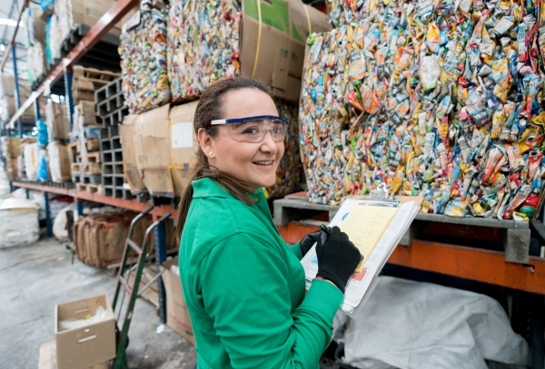 Worker documenting recycled packaging
